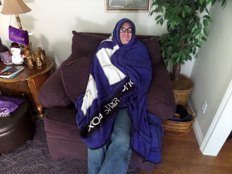 Phil wrapped in a Dr. Who TARDIS blanket