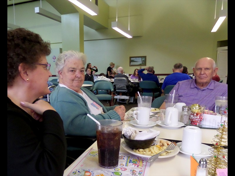 Granddad, Ann and Pam in the lunch room